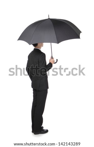 Business Man with an umbrella , concept for business, isolated against white background, asian male model - stock photo