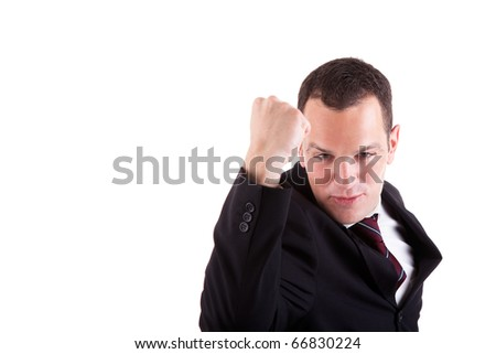 business man with arm raised in victory sign, isolated on white background. Studio shot - stock photo