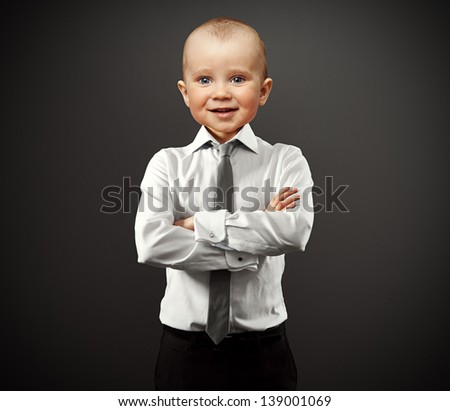 business man with baby face over grey background - stock photo