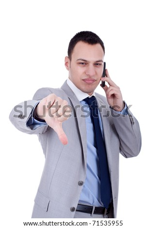 Business man with bad news on his cell phone disapproving - stock photo