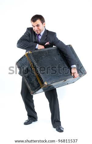 Business man with big old suitcase isolated on white background. Studio shot.