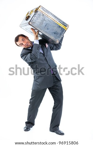 Business man with big old suitcase isolated on white background. Studio shot. - stock photo