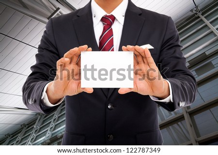 Business man with blank card