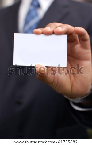 Business man with blank card - stock photo