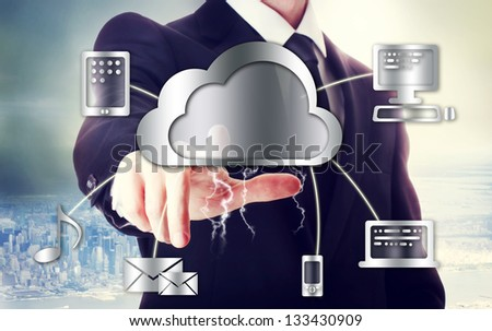 Business man with cloud computing theme with big city backdrop - stock photo