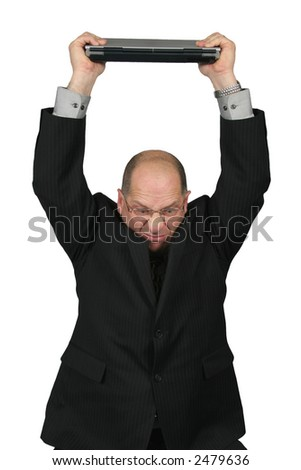 Business man with Computer over his head, getting ready to break it. - stock photo
