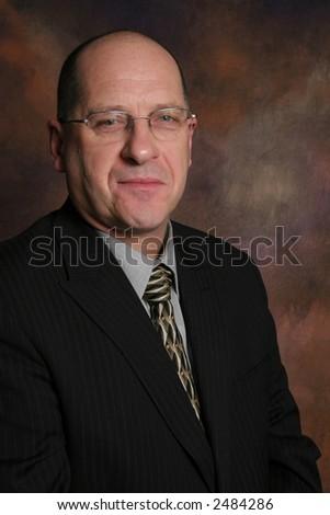 Business man with dark background - stock photo
