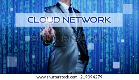 Business man with digital background pressing on button cloud network - stock photo