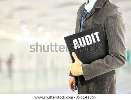 business man with document file word audit with bokeh background - stock photo