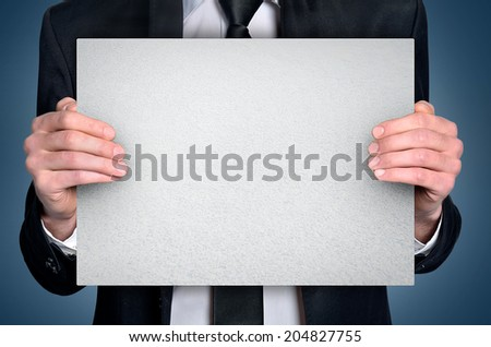 Business man with empty board - stock photo