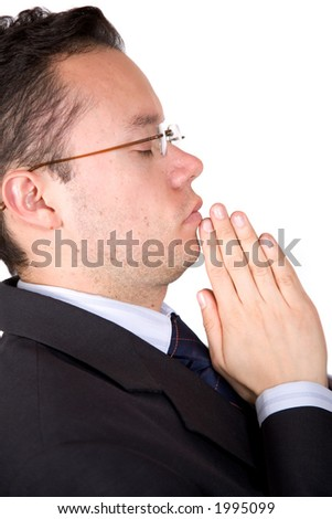 business man with eyes closed doing a prayer over a white background