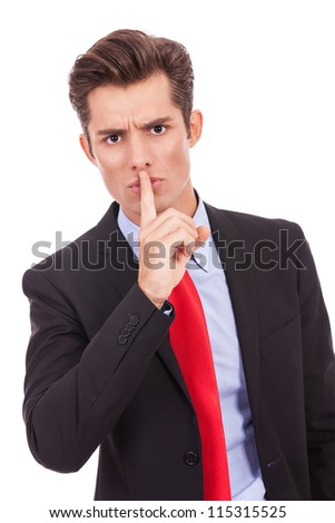 business man with finger on his lips making the quiet gesture - stock photo