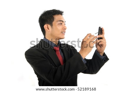 business man with gadgets - stock photo