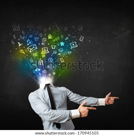 Business man with glowing media icons exploding head concept - stock photo