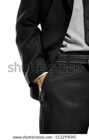 Business man with hand in pocket isolated over white background - stock photo