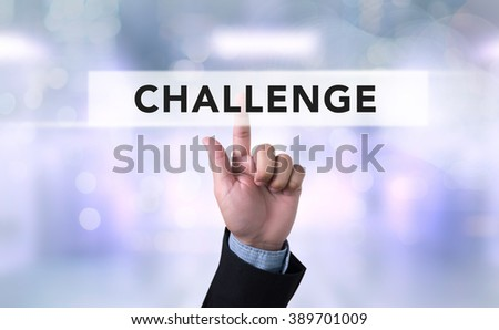 Business man with hand pressing a button on blurred abstract background, Challenge - stock photo