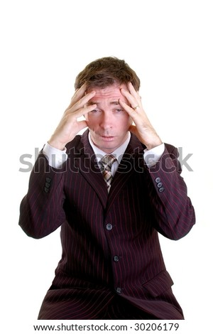 business man with hands on head stressed out - stock photo