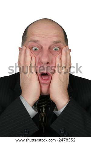 Business man with hands to face with shocked expression - stock photo