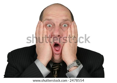 Business man with hands to his face with shocked expression - stock photo
