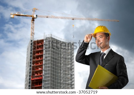 business man with hard hat in a erection yard - stock photo