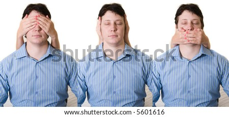 Business man with hear no, see no, and speak no evil - stock photo