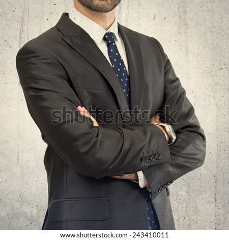 Business man with his arms crossed over isolated background - stock photo