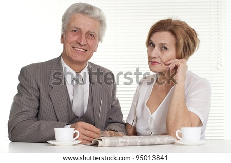 Business man with his secretary on a light background