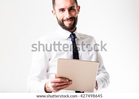 business man with his tablet smiling because he doesn't know a robot is going to stand in for him - stock photo