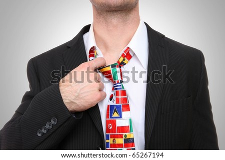 Business man with international global flag tie - stock photo