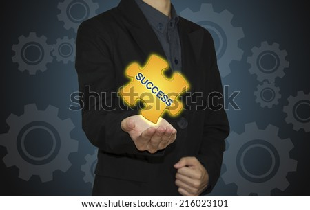 """Business man with  jigsaw puzzle piece  """"SUCCESS""""  - stock photo"""