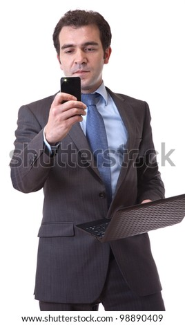 business man with laptop and cellphone, isolated on white background - stock photo