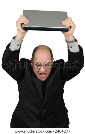 Business man with Laptop over head, man is mad with his computer - stock photo
