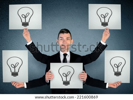 Business man with many ideas - stock photo