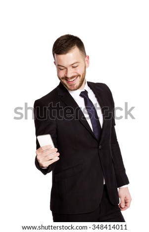 Business man with  mobile phone isolated on white - stock photo