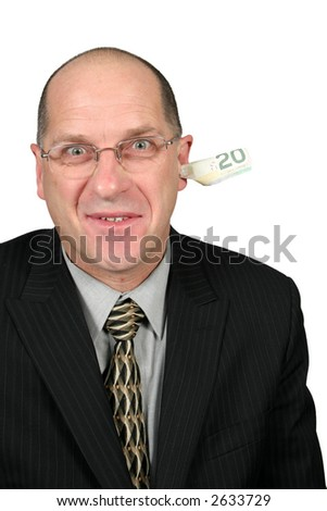 Business man with money coming out of his ear - stock photo