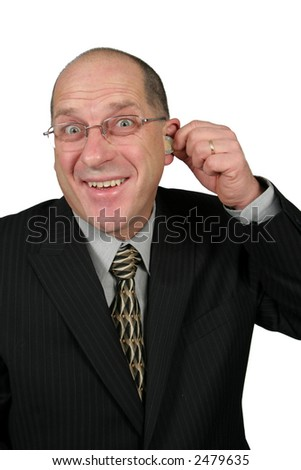 Business man with Money coming out of his ears - stock photo
