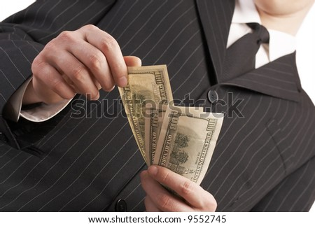 business man with money in his hand, counting and paying with american dollars