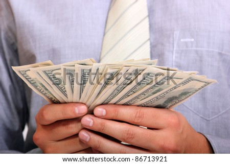 business man with money in his hands - stock photo