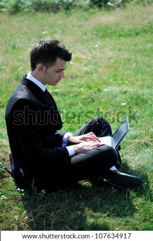 Business man with notebook in nature