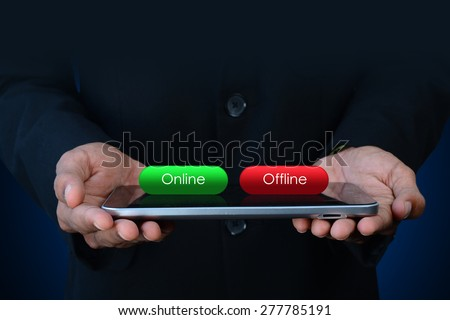 Business man with online and offline button - stock photo