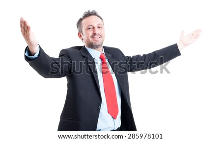 Business man with open arms looking into the camera on white background - stock photo