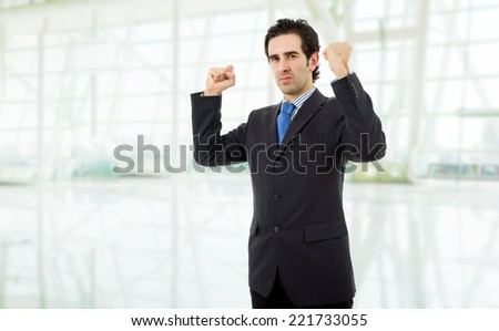 business man with open arms winning, at the office - stock photo