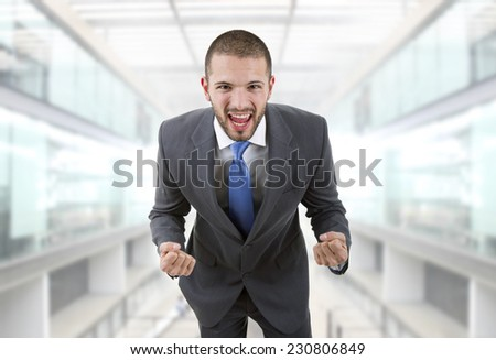 business man with open arms winning at the office - stock photo