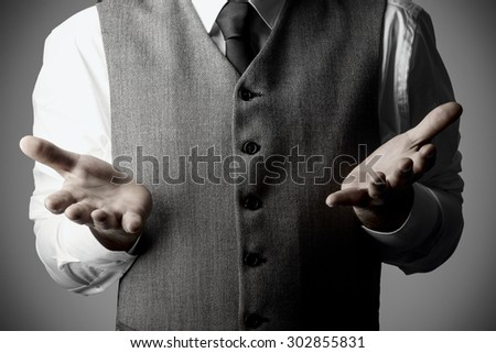 Business man with open hand palms as a sign of not knowing or get something, Business Concept - stock photo