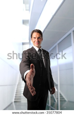 business man with open hand ready to seal a deal - stock photo