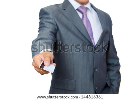 Business man with pastic card in hand on white - stock photo