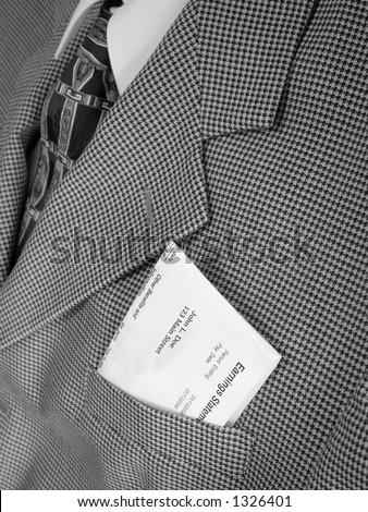 business man with pay check in pocket - stock photo