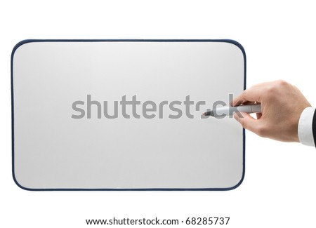Business man with pen points out position on blank whiteboard with room for text or images