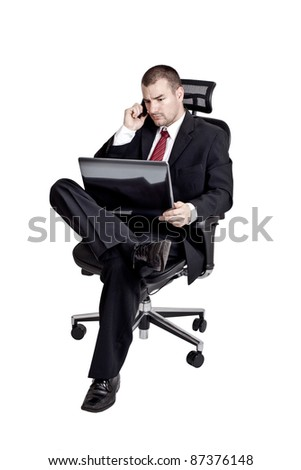 Business man with phone and laptop. Isolated on white background - stock photo
