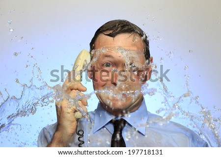 business man with phone in hand is showering - stock photo